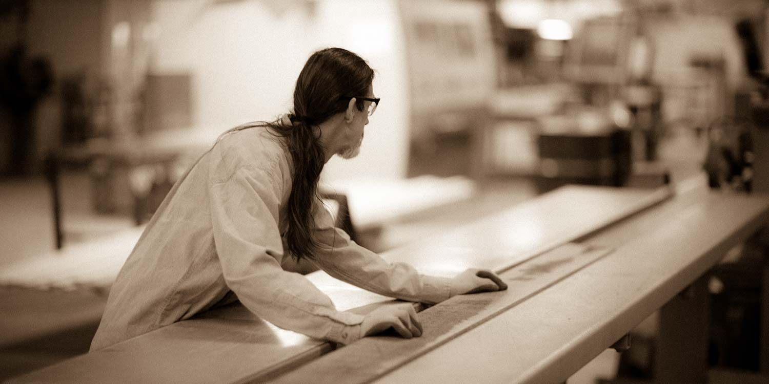An image of a worker at Kstair working with the lumber for their custom millwork