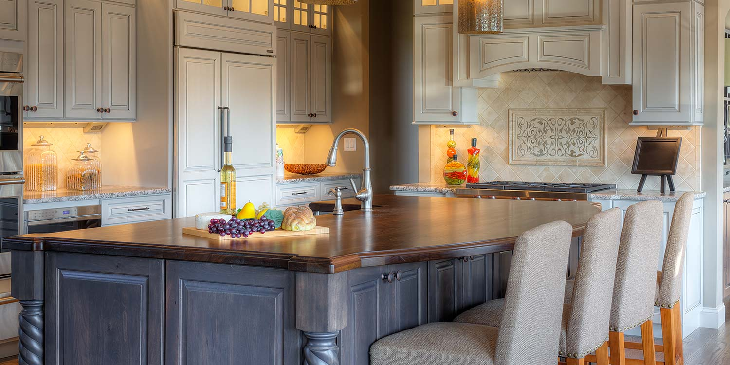 An image of a complete kitchen featuring a beautiful, custom, wood countertop