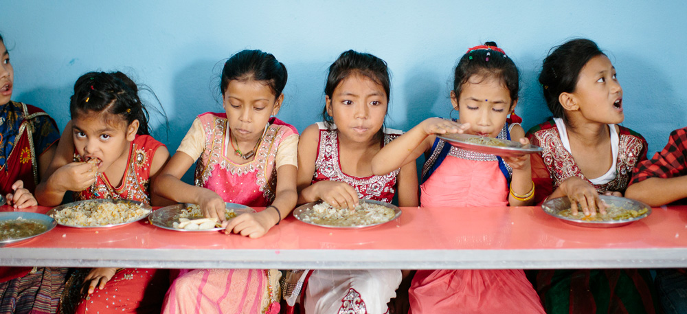 Girls at the contact center in Kathmandu enjoy some lunch.